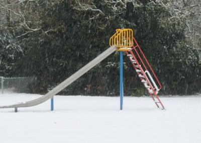 Children's slide after a snowfall